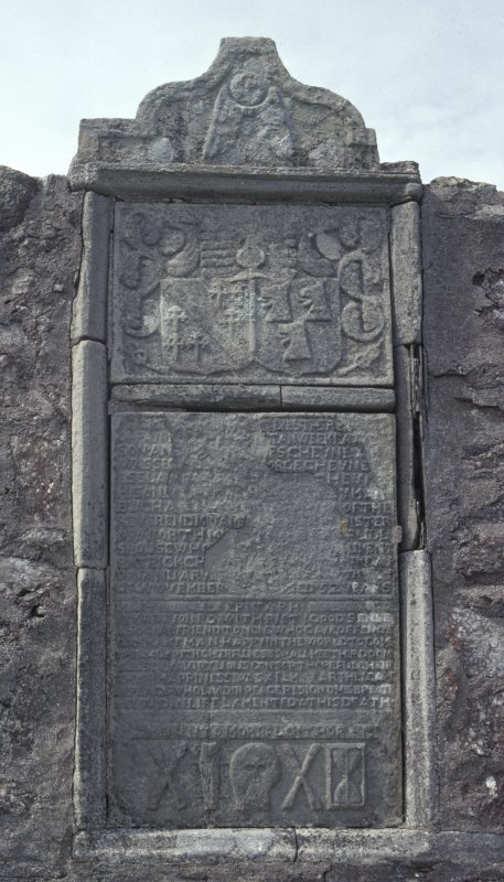 View of large wall monument with coat of arms and death symbols, Cross Kirk, Shetland.
