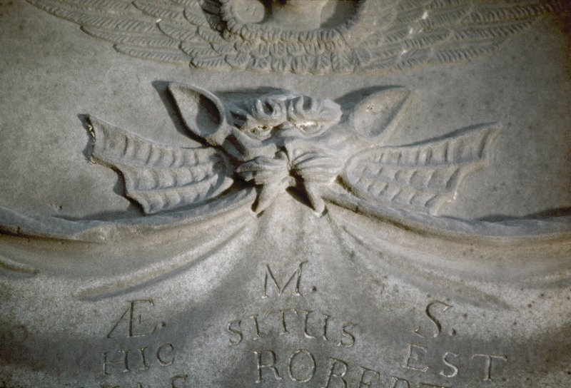 Detail of gravestone showing possible Green Man, Greyfriars Church burial ground, Edinburgh.