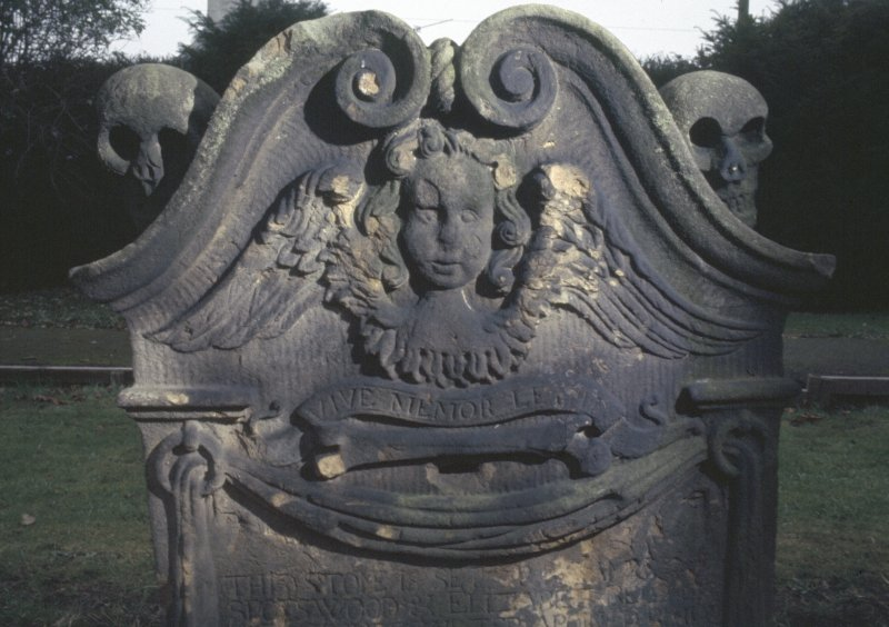 Detail of headstone with winged angel, North Leith Parish Churchyard, Edinburgh.