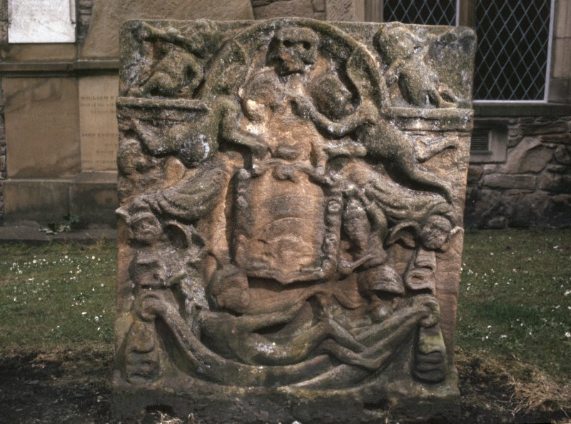 View of headstone showing trumpeting putti and death head, Auld Kirk of Ayr churchyard.
