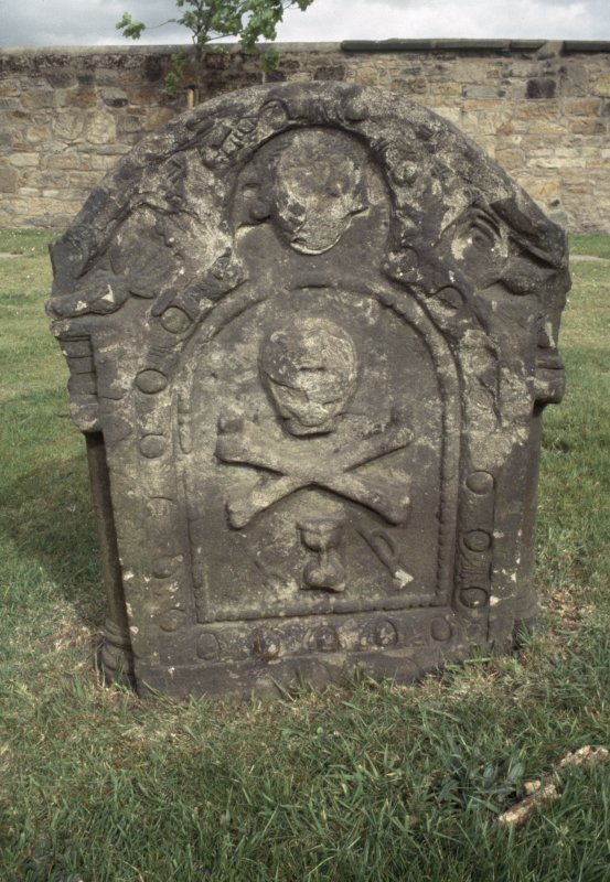 View of headstone with skull and cross bones, Govan Old Parish Church  burial ground.
