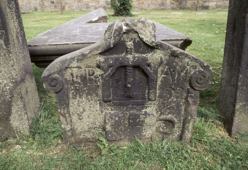 View of partly buried headstone, Govan Old Parish Church burial ground.