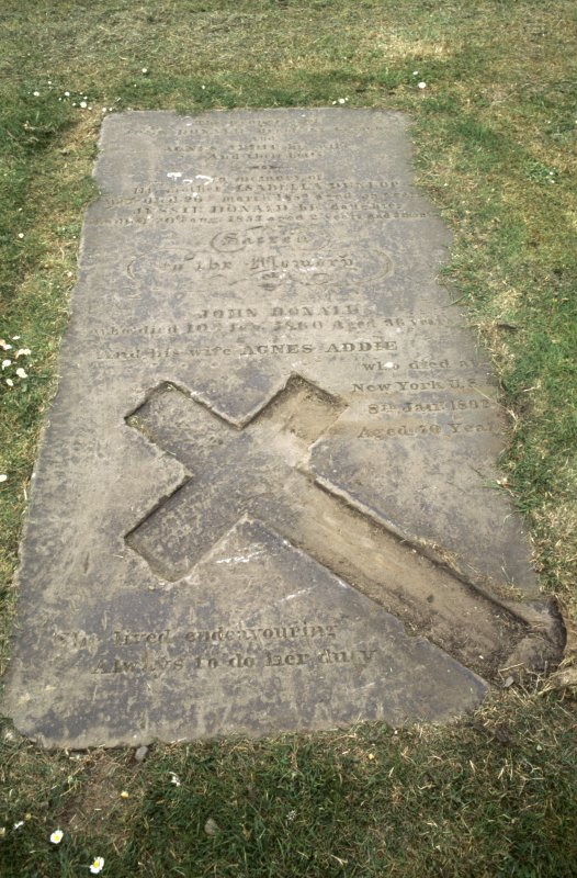 View of graveslab with incised cross for John Donald d.1860 and Agnes Addie d1892, Govan Old Parish Church burial ground.