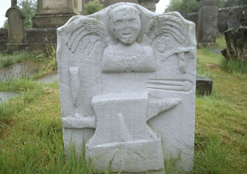 View of headstone 1746 with winged soul and smith's tools, Muirkirk Parish Churchyard.