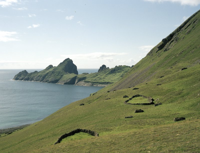 St Kilda, Village Bay. General view of the enclosures at Gearraidh Ard with Dun in the background.