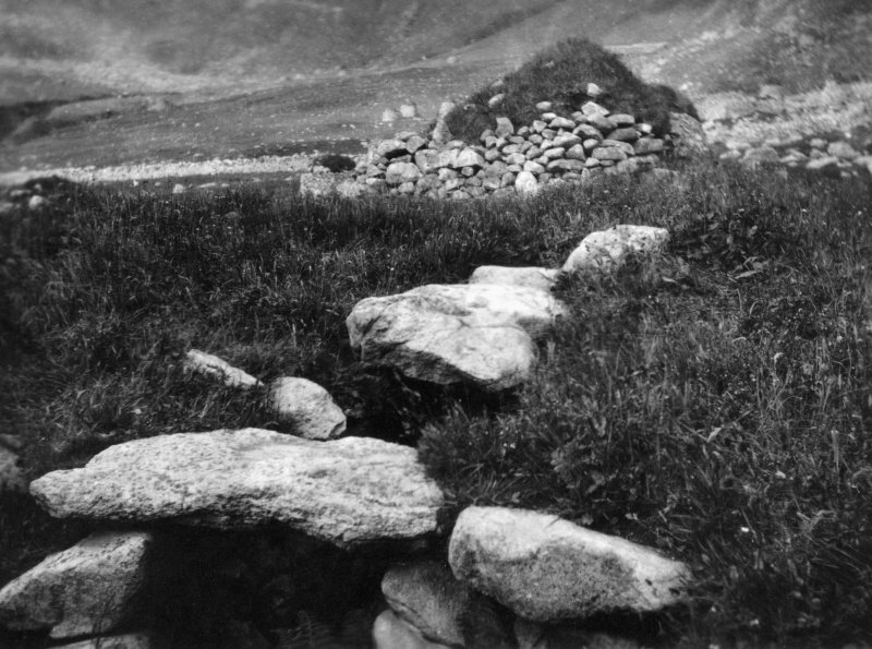 A view of the exterior of the Iron Age souterrain on Hirta, St Kilda, looking over the entrance to cleit 70 beyond. This image was sent to RCAHMS by a Captain Grant, 1924.