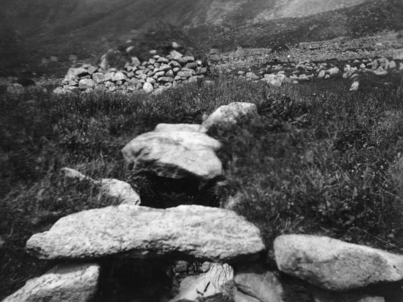 A view of the exterior of the Iron Age souterrain on Hirta, St Kilda, looking over the entrance to cleit 70 beyond. This image was sent to RCAHMS by a Captain Grant c1924.