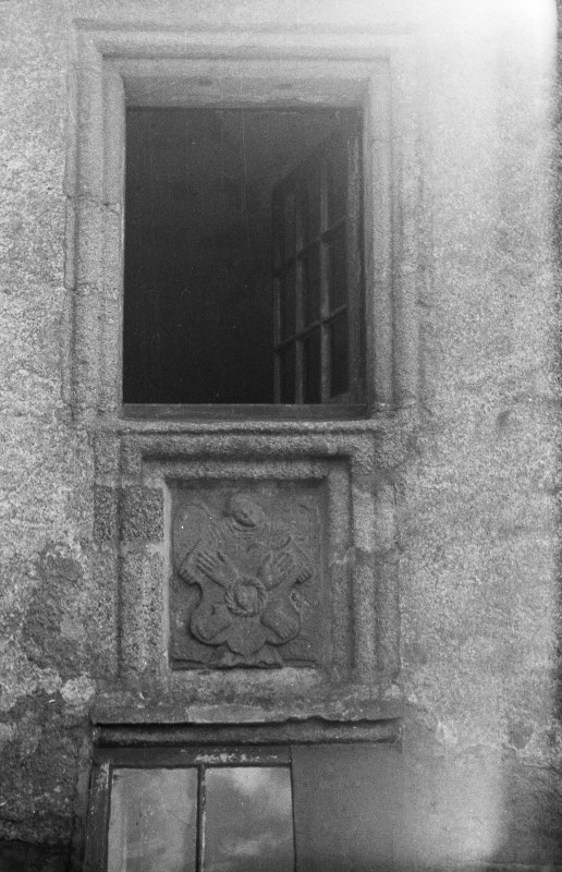 Castle Fraser. Detail of Arms of Christ plaque outside chapel window.
