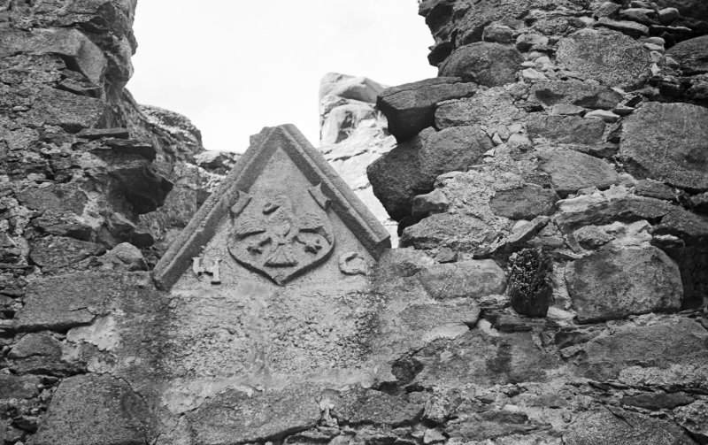 Glenbuchat Castle. Detail of pediment reset in room over kitchen.