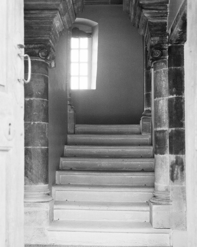 Interior. View of stair through outer door.