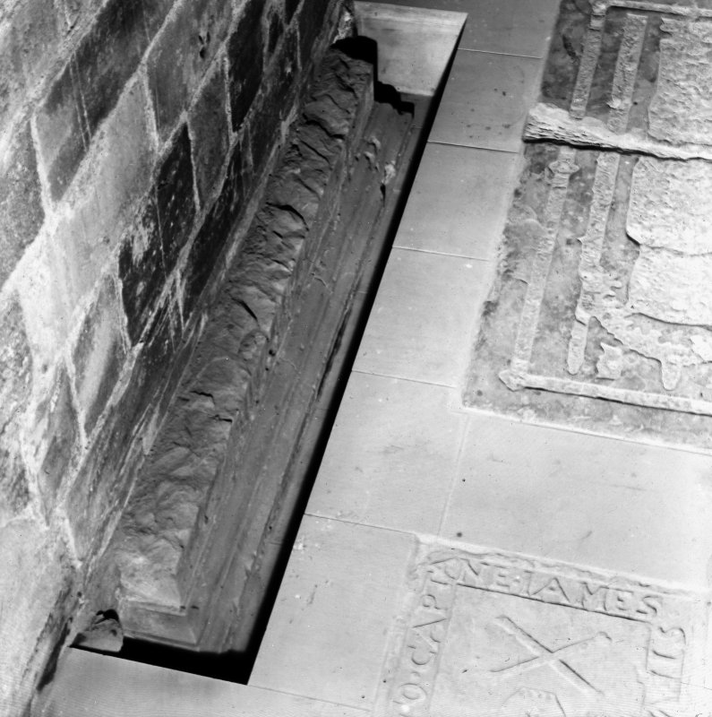 Detail of carved stonework and tomb stones in floor.