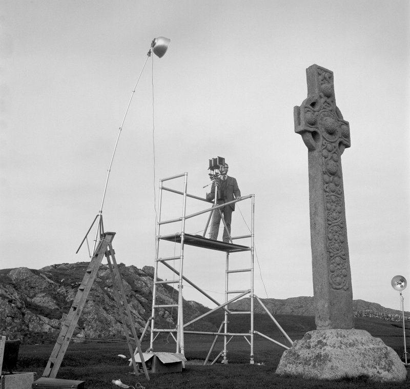 Geoffrey B Quick, RCAHMS, photographing St Martin's Cross, Iona.