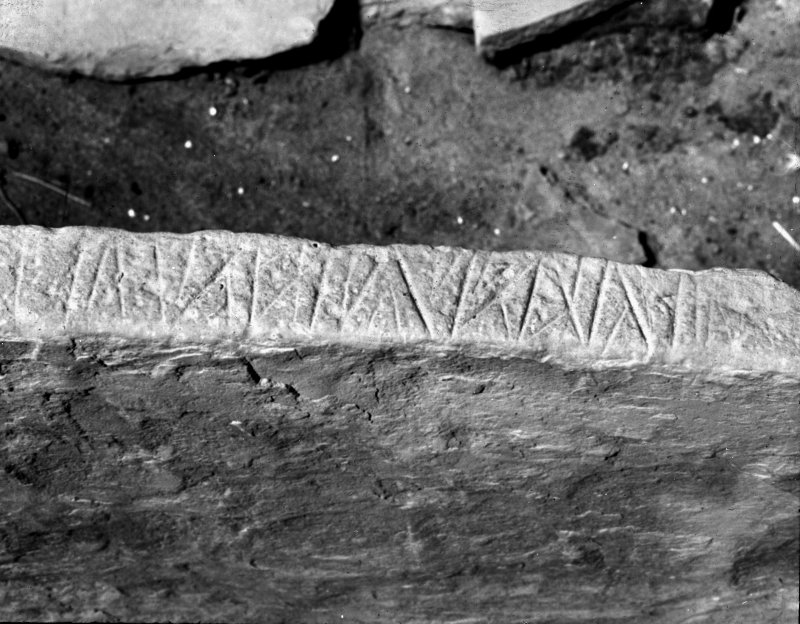 Detail of neolithic carving from the edge of a bed slab in House 7, Skara Brae.