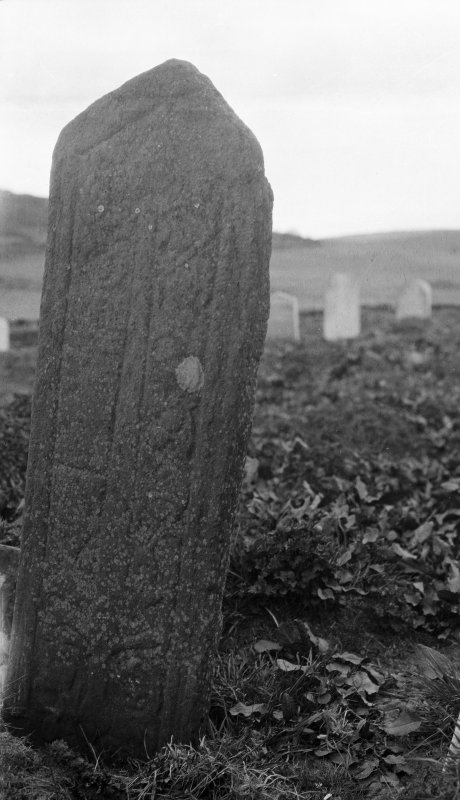 Skye, Glen Dale, St Comgan's Chapel. View of late medieval graveslab, reused as headstone and set inverted in ground.