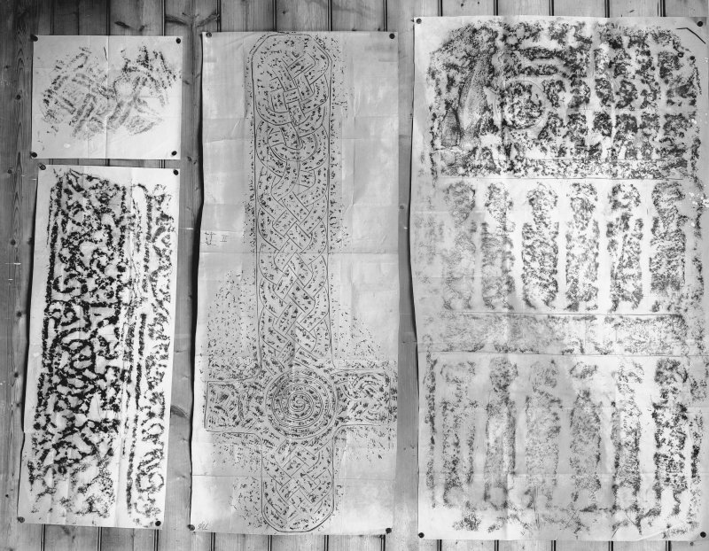 Photographic copy of four rubbings. The right rubbing shows the Apostles Stone cross slab, Dunkeld Cathedral. The remaining stones are unidentified.