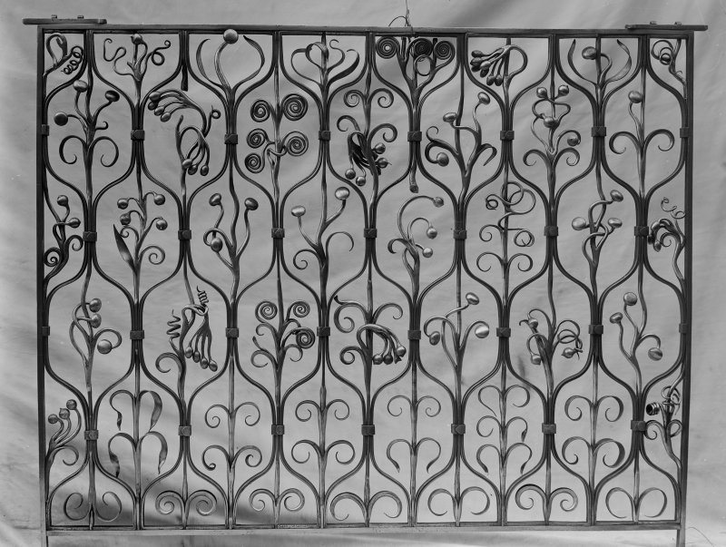 View of wrought iron grille decorated with scrolls and berries, possibly for Ardkinglas House