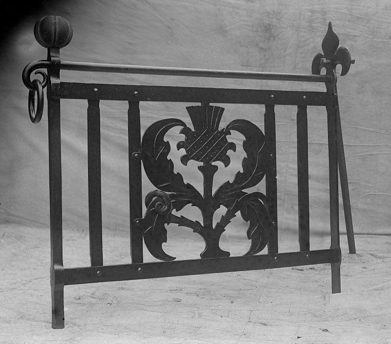View of wrought iron gate with thistle motif, possibly made for the main spiral staircase at Ardkinglas House