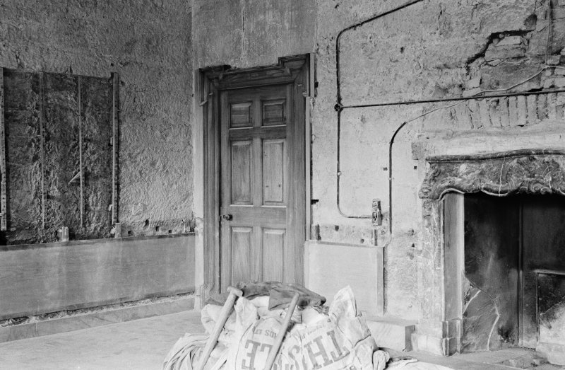 Interior view of entrance hall in Gilmerton House after fire showing signs of earlier work.
