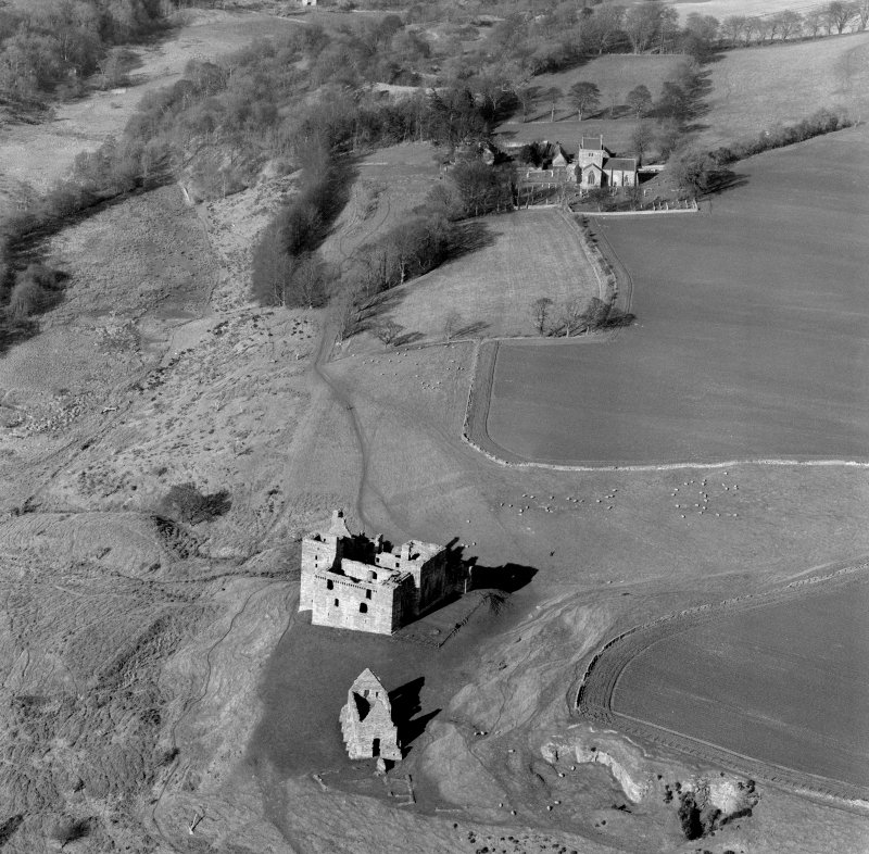 Oblique aerial view of Crichton Castle with Crichton Parish Church visible.