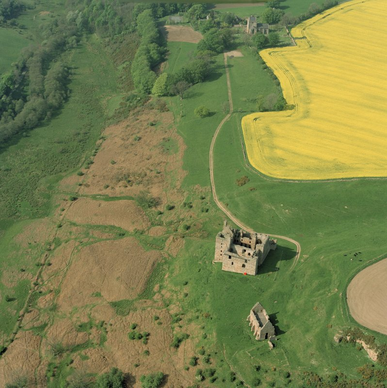Oblique aerial view of Crichton Castle and Crichton church, taken from the SSW.