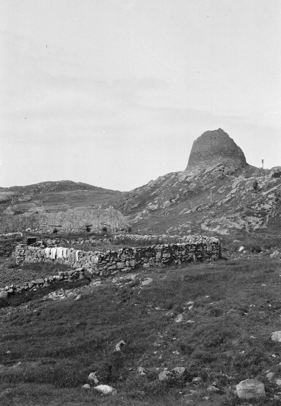 Dun Carloway. View of broch and blackhouse from south-east.