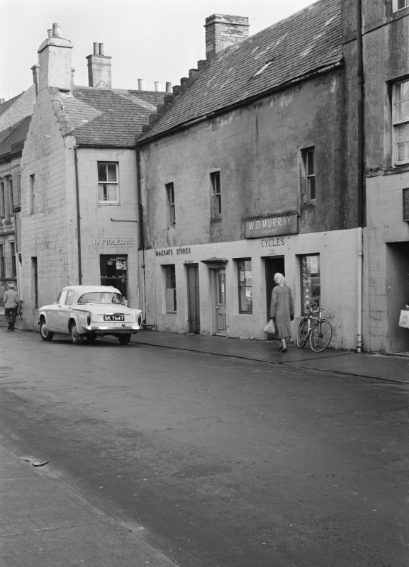 View of 11-17 High Street, Thurso, from west showing W D Murray bicycle shop, MacKay's Stores and R Fidler shop.