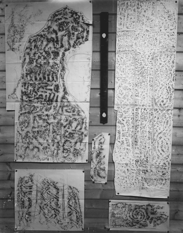 Photographic copy of five rubbings. The upper left rubbing shows the face of the Apostles Stone cross slab in Dunkeld Cathedral, the remaing stones are unidentified.