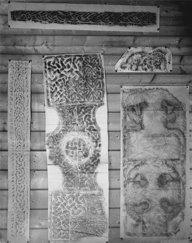 Photographic copy of five rubbings. The upper and bottom right rubbings show a cross slab in St Serf's Church, Dunning and the middle rubbing shows the Winwick cross in St Oswald Church, Cheshire. The other two stones has not been identified.