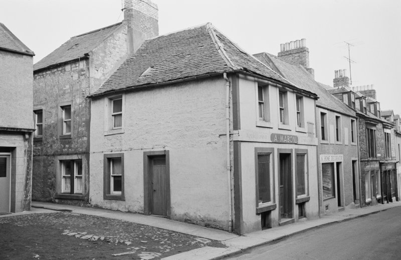 View of 8 Castle Street, Duns, from north west showing A Mabon tobacconist and confectioner and a home decorator shop.