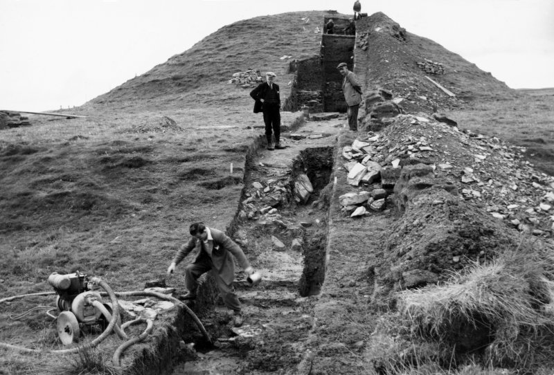 View of Vere Gordon Childe's excavation at Maes Howe, showing Childe on site at the opening of the site