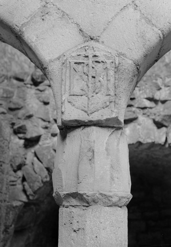 Detail of column cap and monogram at north range, Crichton Castle