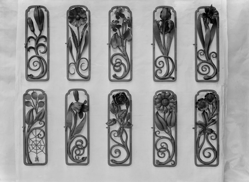 Detail of wrought iron plates with flower decorations