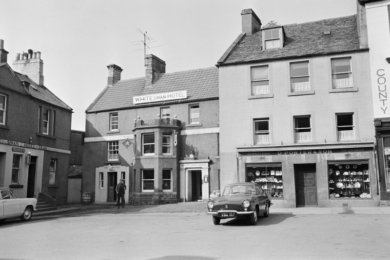 View of 31-34 Market Square, Duns, from south showing White Swan Hotel and D Porter and Son Jewellers and Opticians