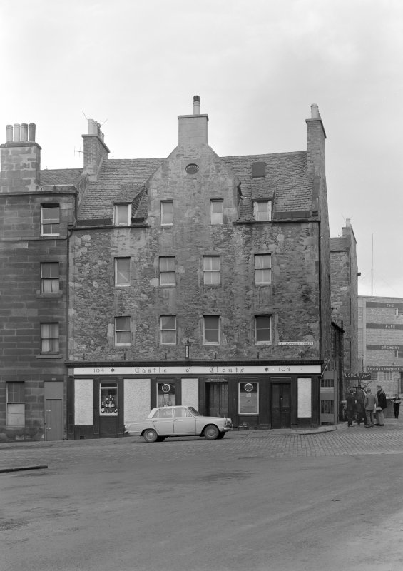General view of the front facade of 104 St Leonard's Street, Edinburgh, including Castle o' Clouts, from SW and part of the Usher Brewery.