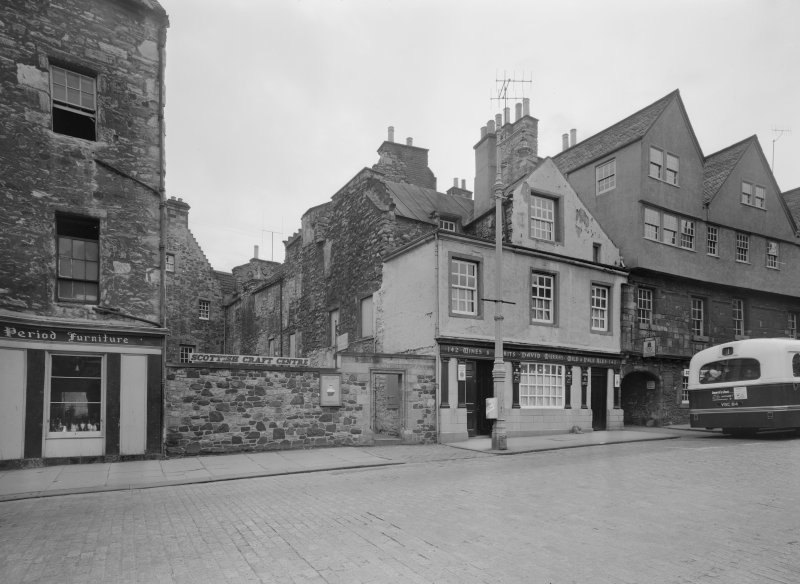 View of Huntly House and Acheson House, Canongate and the entrance to Bakehouse Close, showing the premises of George Period Furniture, David Murray Wines & Spirits and the Scottish Craft Centre
