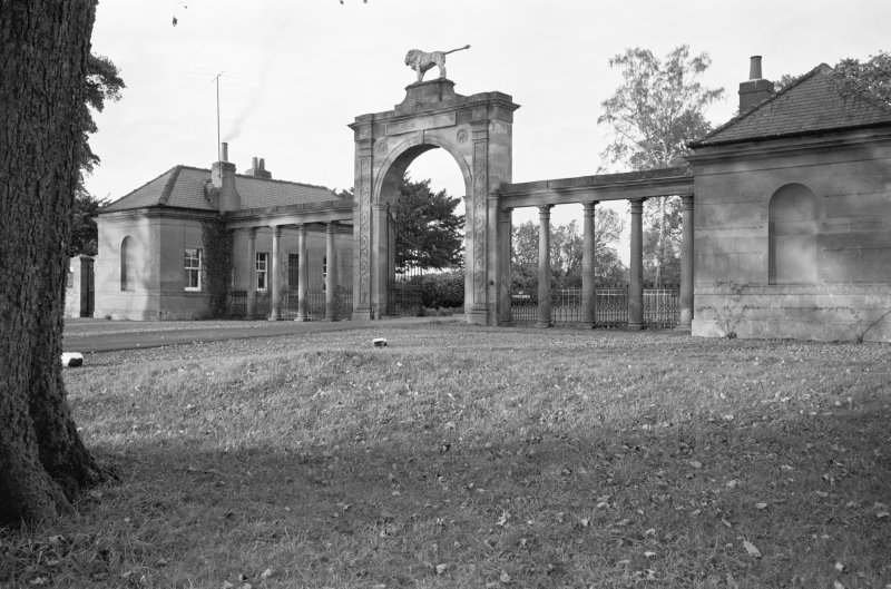 View from south of the Lion Gate and West Lodge, Ladykirk House