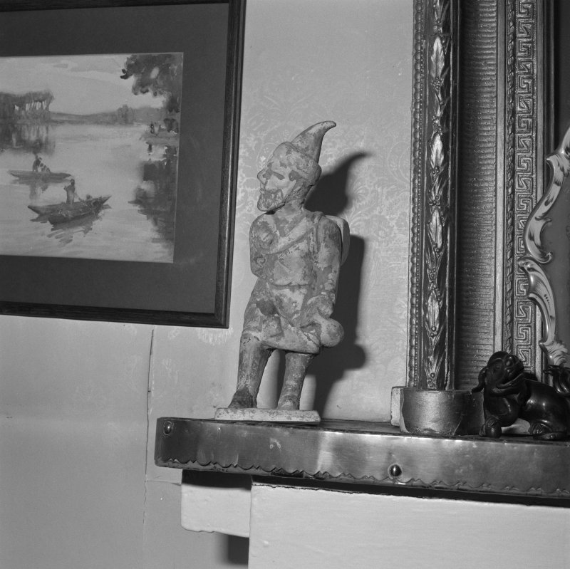 First floor, living room, mantelpiece, sculptured figure and picture, detail