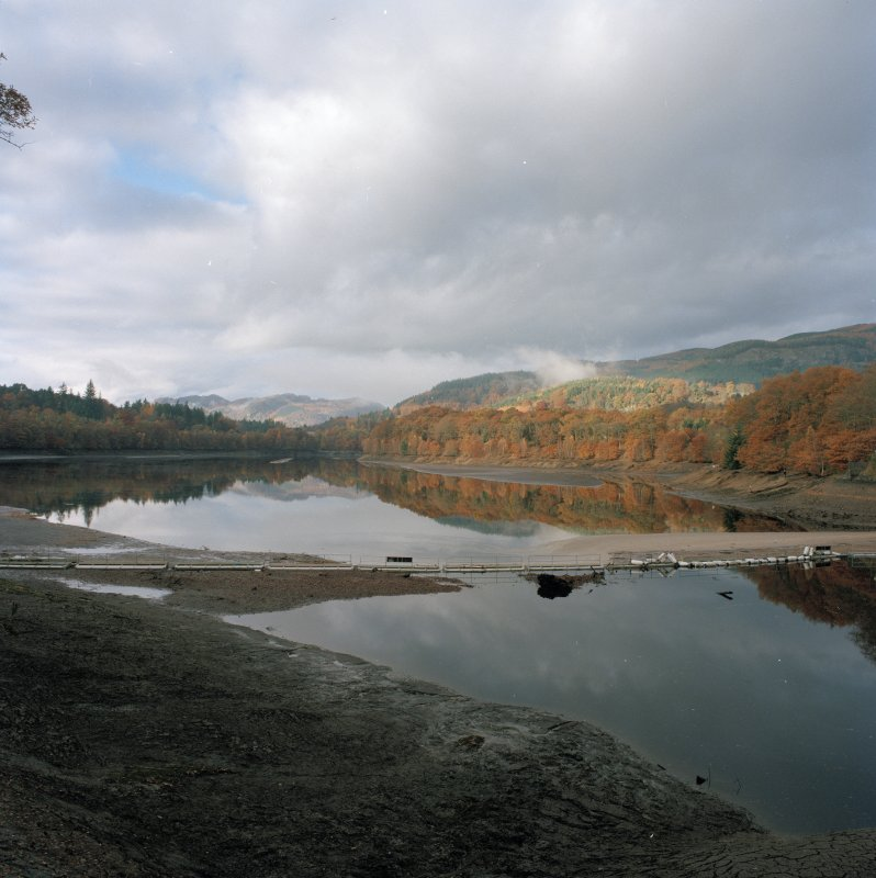 General view of partially drained Loch Faskally from SE