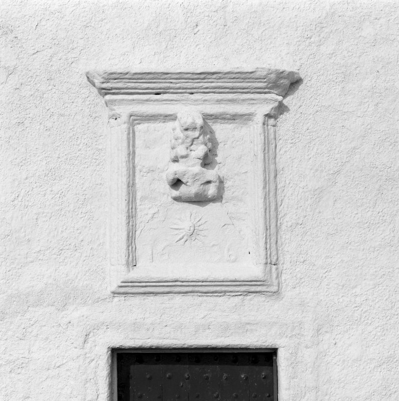 Isle of May.  The Beacon.  Detail of carved panel above entrance doorway in South front.
