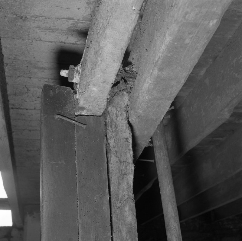 Stable, detail of wooden beams supporting Caithness slab partition.