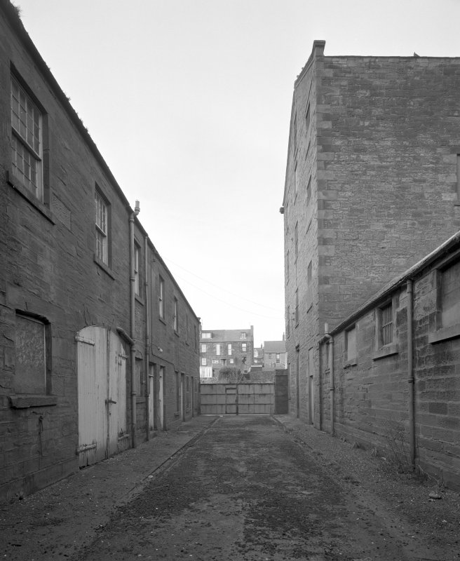 View from E showing cooperage and office range, main gates, and high mill.