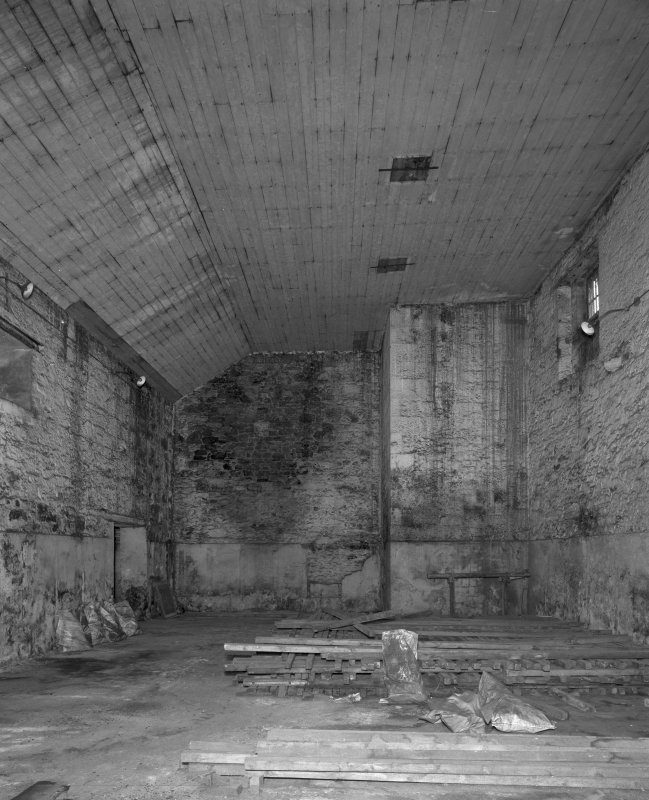 Interior. View from W within former boiler house, showing base of boiler house chimney.