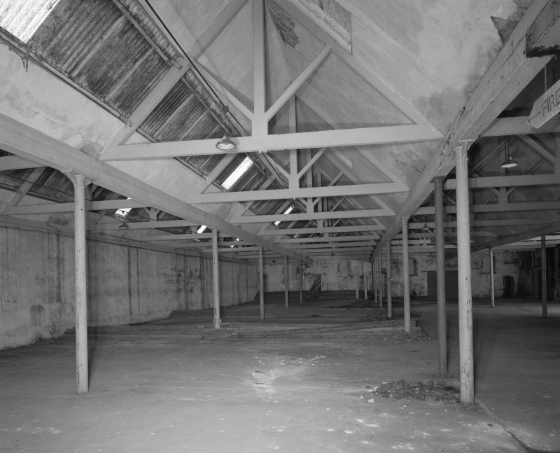 Interior view from W within single-storeyed (possibly weaving) shed to rear of high mill.
