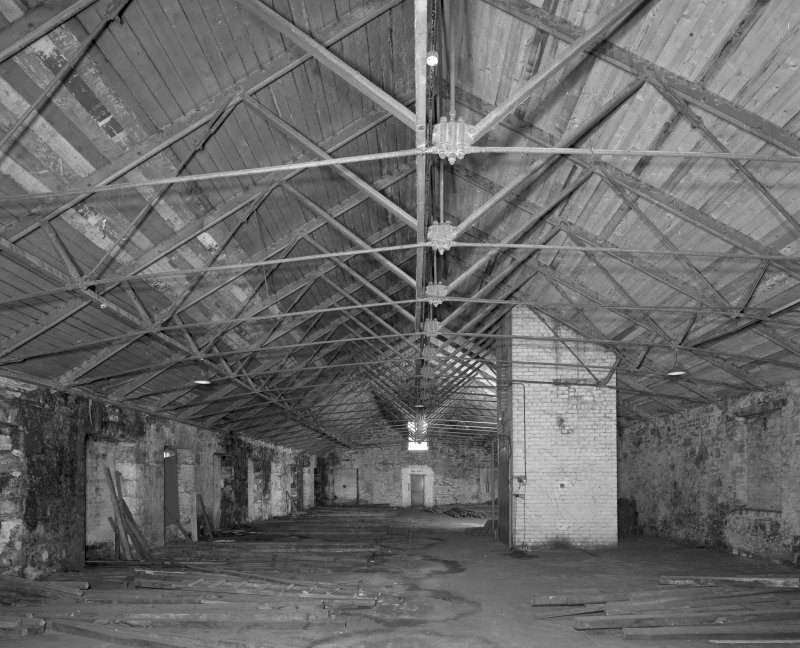 Interior. View of attic of high mill, showing wrought-iron roof trusses, and top of lift shaft (added when building was converted to bonded warehouse).