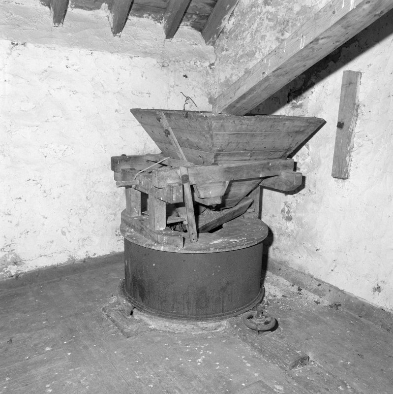 Interior. Detail of one of the two sets of millstones, chute and hopper.