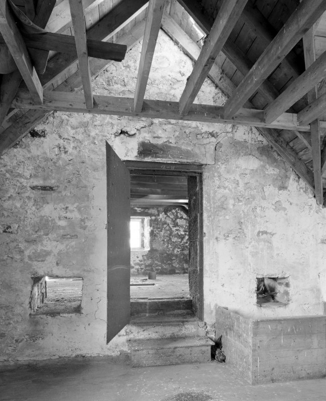 Interior. View showing door providing access from mill onto kiln floor.