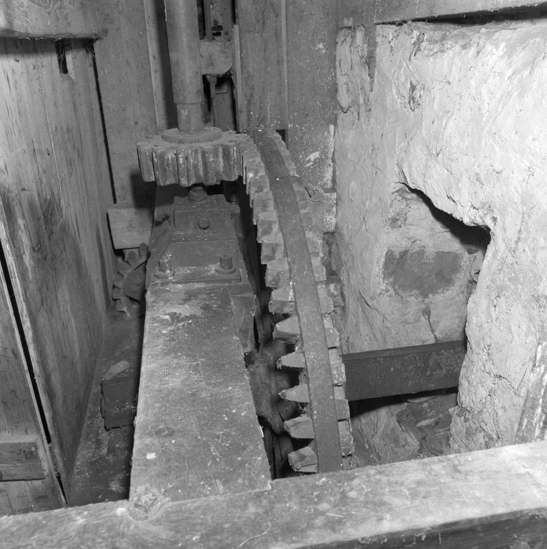 Interior. View of ground-floor level within gear cupboard, showng water wheel axle and pit wheel (centre).