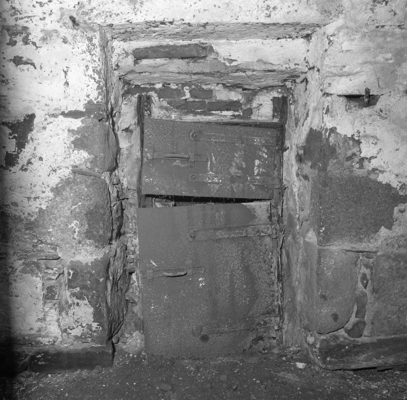 Interior. Detail of steel doors of firebox at base of kiln.