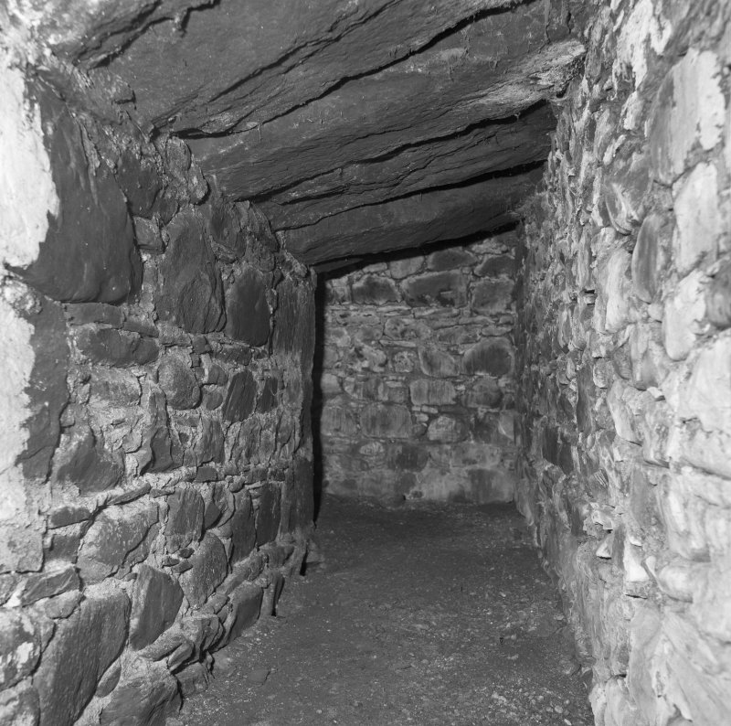 Interior. Detail of lower level of kiln, showing the slabbed contruction of the invert (above), and the rubble-built firebox (left).