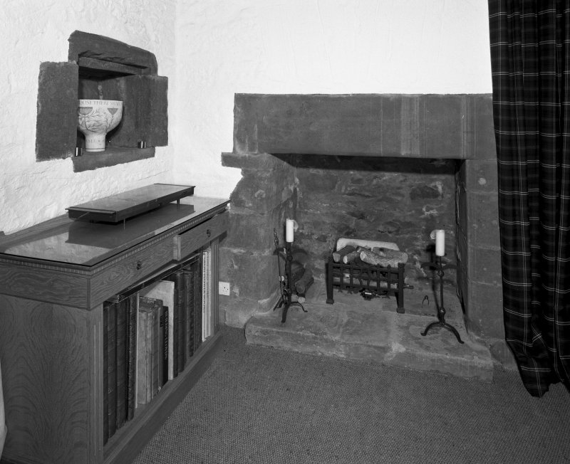 Interior. Second floor dining room detail of fireplace and wall niche.